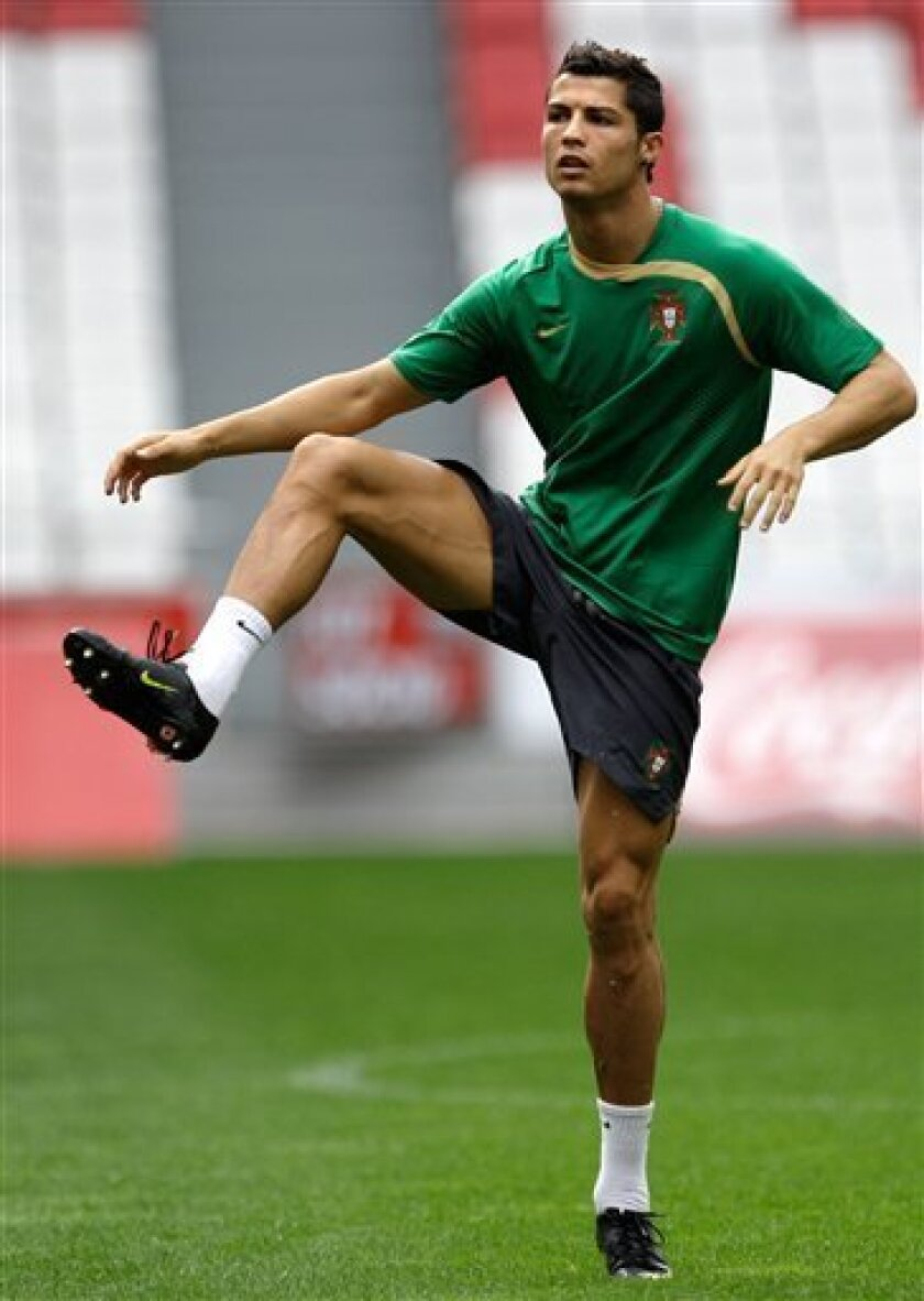 Player Cristiano Ronaldo warms up before a training session of Portugal's soccer team Friday, Oct. 9 2009, at the Luz stadium in Lisbon. Portugal will face Hungary in a World Cup qualifying match Saturday and Ronaldo is expected to be fit to play after recovering from an injury in his right ankle. (AP Photo/Armando Franca)