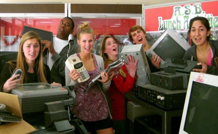Members of the Associated Student Body (ASB) at La Jolla High School pose with some of the old electronics they are gathering for La Jolla High School's annual E-Waste Collection Day, 10 a.m. to 3 p.m. Saturday, Jan. 31, 2015. People can drive up and drop off their unwanted electronic goods.