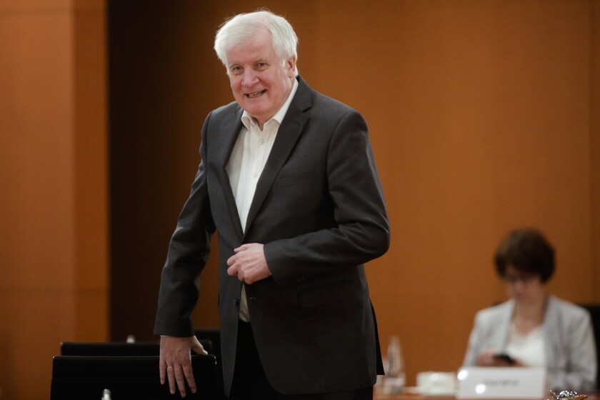 German Interior Minister Horst Seehofer arrives for the cabinet meeting at the chancellery in Berlin, Germany, Wednesday, July 29, 2020. Olaf Scholz leads the meeting because German Chancellor Angela Merkel is on vacation. (AP Photo/Markus Schreiber, Pool)