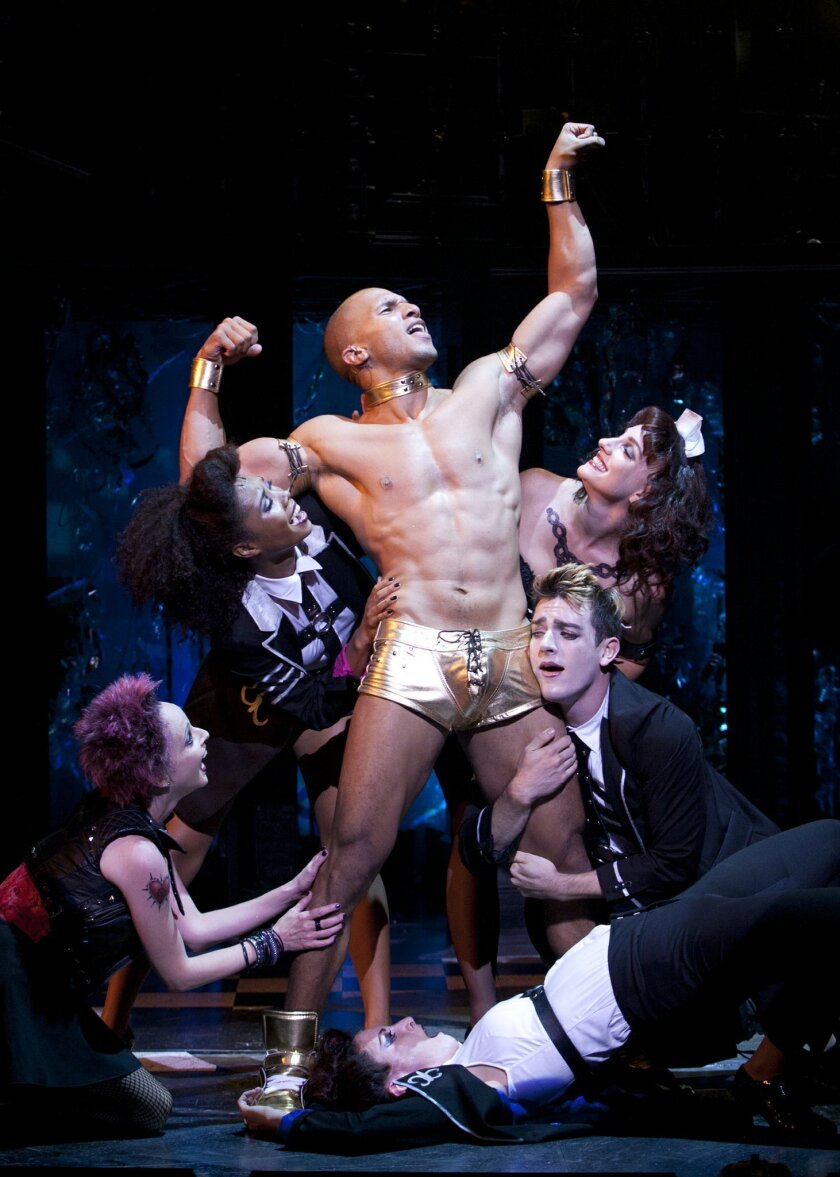 Sydney James Harcourt as Rocky surrounded by the cast of Richard O'Brien's The Rocky Horror Show, directed by James Vasquez at The Old Globe. Photo by Henry DiRocco.