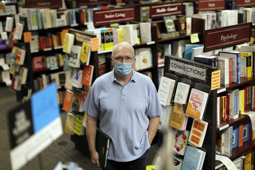 Joel Sheldon among the shelves in his bookstore
