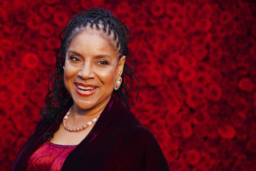 Phylicia Rashad poses for a photo on the red carpet