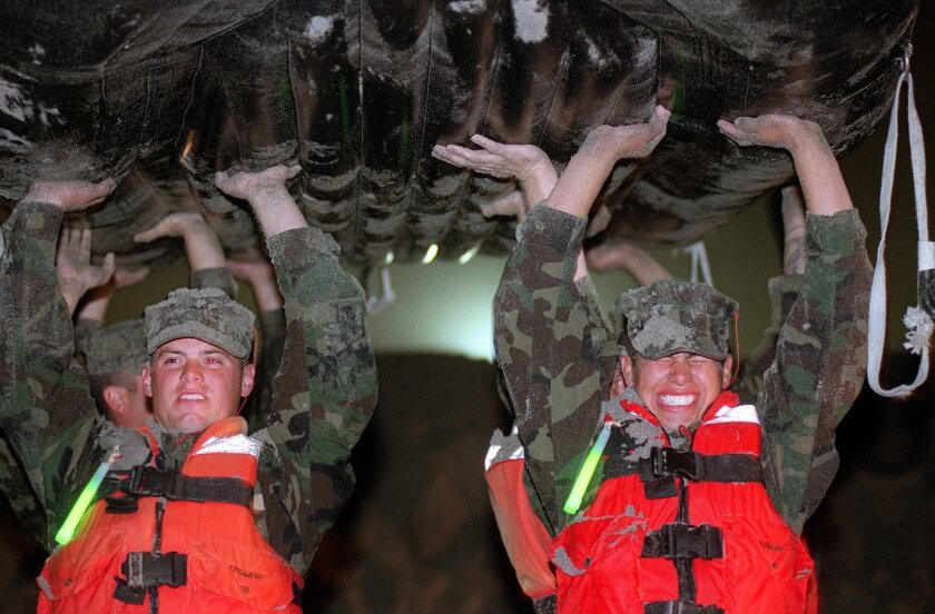 Navy SEAL trainees at Naval Amphibious Base Coronado undergoing training during Hell Week are required to carry their rubber boat weighing several hundred pounds everywhere they go.