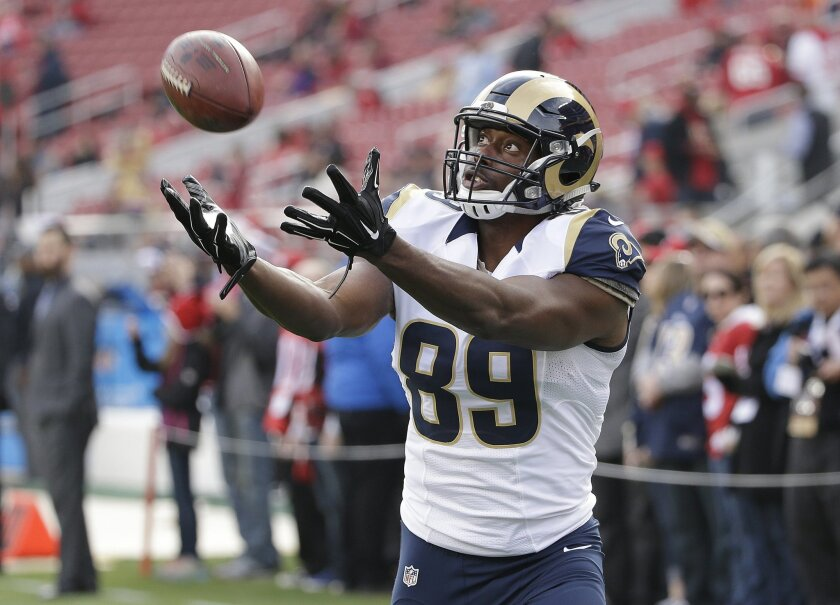 FILE - In this Jan. 3, 2016, file photo, St. Louis Rams tight end Jared Cook warms up before an NFL football game against the San Francisco 49ers in Santa Clara, Calif. The Green Bay Packers made a surprise move into free-agency by signing Cook on Monday, March 28, 2016. (AP Photo/Marcio Jose Sanchez, File)