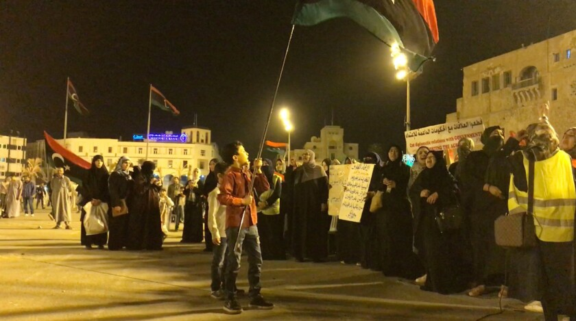 Protesters gather in Tripoli's Martyrs' Square for a demonstration against the offensive by Gen.