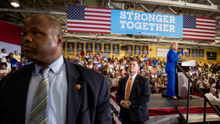 Members of the Secret Service keep watch as Democratic presidential candidate Hillary Clinton speaks at a rally this month in Charlotte, N.C.