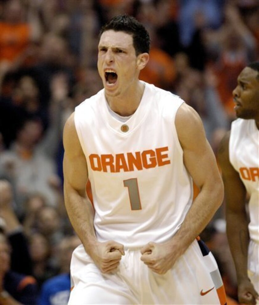 Syracuse's Andy Rautins yells after hitting a three-pointer against Memphis during the first half of an NCAA college basketball game in Syracuse, N.Y., Wednesday, Jan. 6, 2010. (AP Photo/Kevin Rivoli)