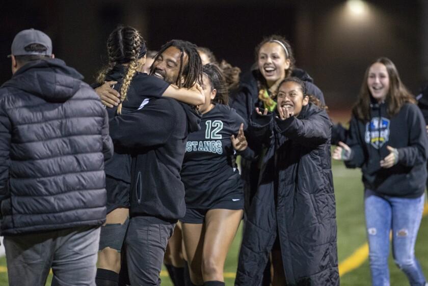 Costa Mesa's head coach Jason Boyce hugs Natalia Guzman after she scored the winning goal against Hi