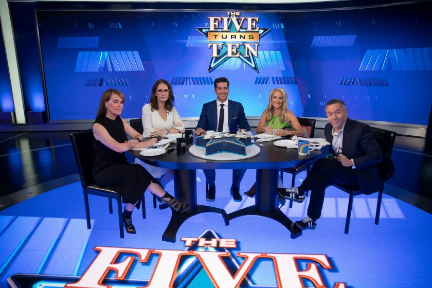 """Three men and two women sit at a round table on the set of Fox News show """"The Five."""""""