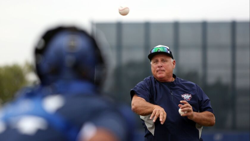 LOS ANGELES, CA-JUNE 22, 2019: Mike Scioscia tosses the ball to catchers training at the Major Leagu