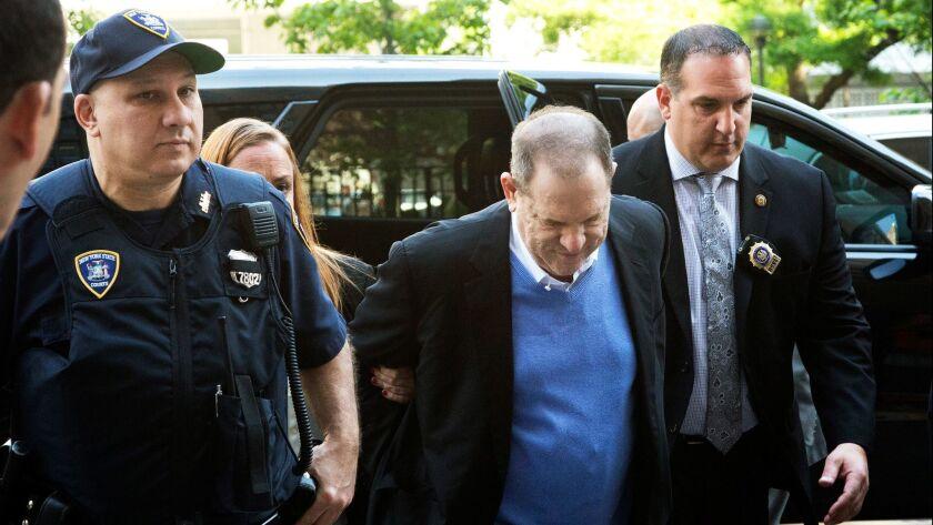Harvey Weinstein is escorted into court, Friday, May 25, 2018, in New York. Weinstein surrendered Fr