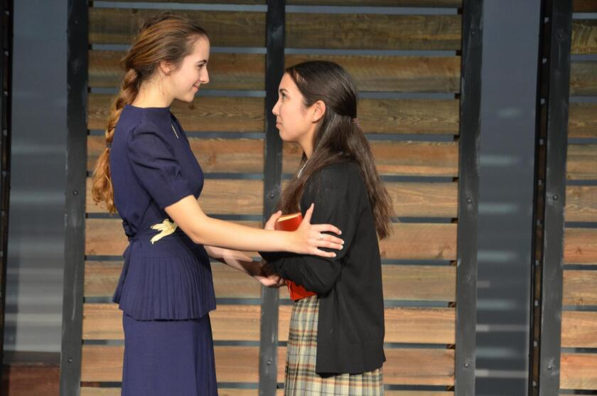 """Amber Marroquin, right, portrays Sala and Hannah Thunstrom plays her companion Ala Gertner in Estancia High School's production of """"Letters to Sala."""""""