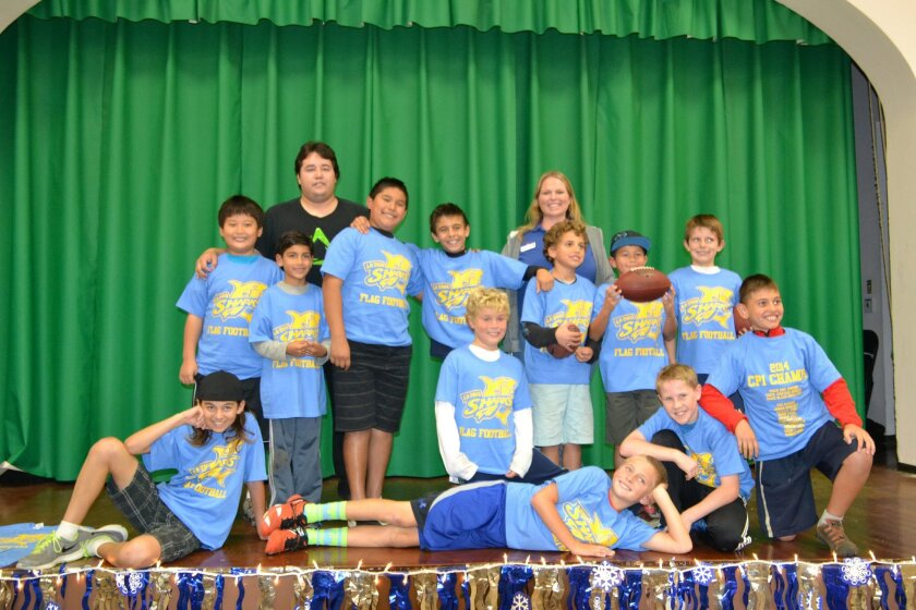 La Jolla Recreation Center's Sharks flag-football team wins the City of San Diego Community Park 1 League Championship. Front: Landyn McKeown, Tristan Laifa, Kevin Steel, Connor Hobbs and Anthony Hall. Back: Michael Yang, Coach Erik Romero, Diego Pereyra, Jesus Mozo, Jagger Bisharat, Recreation Center Director Nicole Ann Otjens, John-Paul Hall, Cash McKeown and Wes Olmert