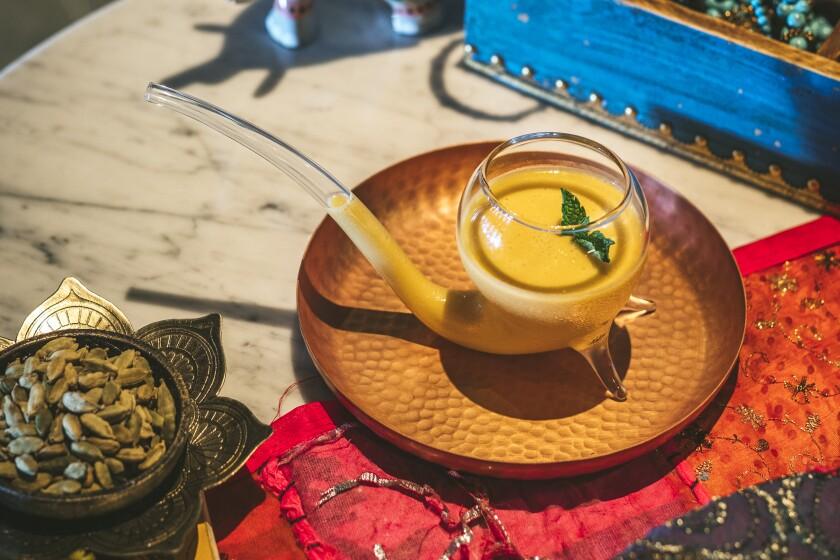 Mango Lassi DSP with mango, yogurt, rum and saffron served with a cardamom cloud