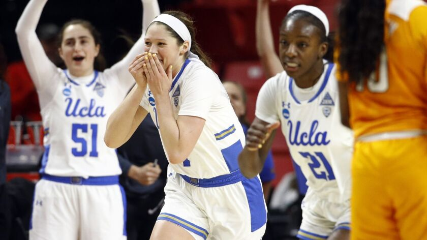 UCLA guard Lindsey Corsaro, second from left, reacts after making a 3-pointer during Saturday's win over Tennessee in the first round of the NCAA tournament.