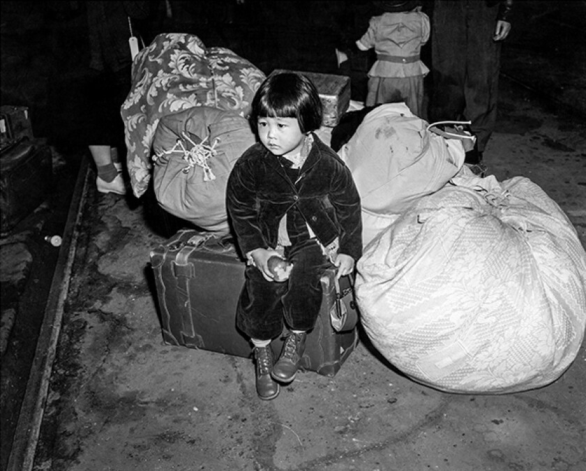 Two-year-old Yuki Okinaga Hayakawa waits at Union Station for a train that will take her and her mother to Manzanar.