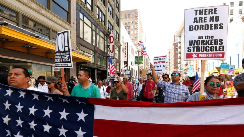 May Day protesters in Los Angeles denounce Trump administration immigration policies. A federal appeals court on Monday heard arguments for and against the administration's revised travel ban.