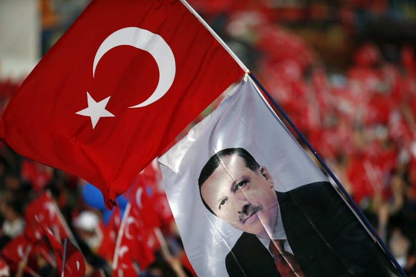 A flag with an image of Turkey's President Recep Tayyip Erdogan waves during celebrations of the 563rd anniversary of the Ottoman conquest of Constantinople, now Istanbul, in Turkey's capital on Sunday.