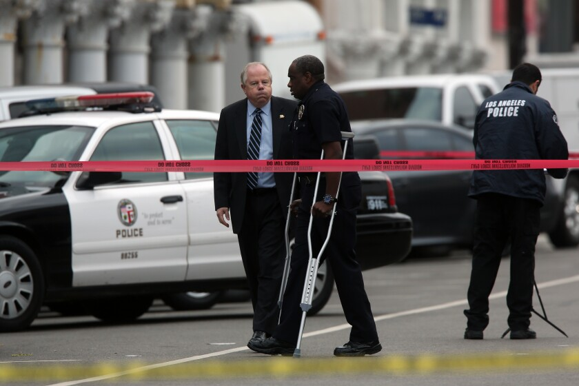 LAPD officer Clifford Proctor, on crutches
