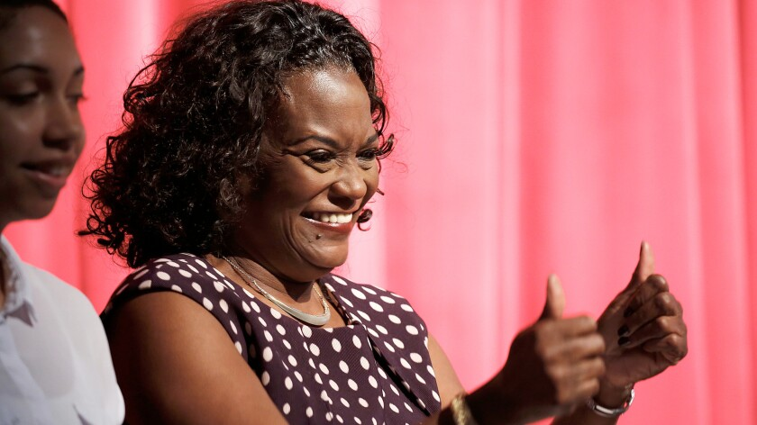 L.A.schools Supt. Michelle King gives a thumbs-up to cheer an audience of school district employees and a best-yet graduation rate.
