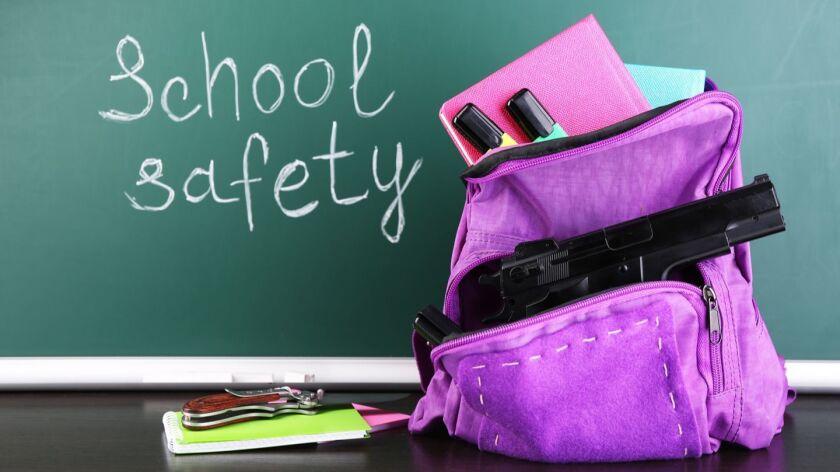 Gun in school backpack on wooden desk, on blackboard background