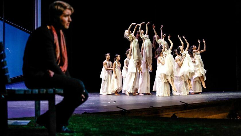 "Tenor Maxim Mironov, as Orpheus, watches dancers from Joffrey Ballet portray the blessed spirits of the Elysian Fields in John Neumeier's production of Gluck's ""Orpheus and Eurydice"" for Los Angeles Opera."