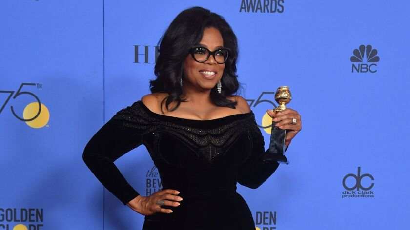 (FILES) This file photo taken on January 7, 2018 shows actress and TV talk show host Oprah Winfrey with the Cecil B. DeMille Award during the 75th Golden Globe Awards in Beverly Hills, California. Americans may love Oprah Winfrey, but most don't want the chat show queen to run for president, although if she did she would beat Donald Trump, a poll revealed on January 12, 2018. Winfrey's rousing speech at Sunday's Golden Globe Awards ceremony ignited speculation that the billionaire entertainment mogul, the first black woman to own a television network, is harboring Oval Office ambitions. / AFP PHOTO / Frederic J. BROWNFREDERIC J. BROWN/AFP/Getty Images ** OUTS - ELSENT, FPG, CM - OUTS * NM, PH, VA if sourced by CT, LA or MoD **