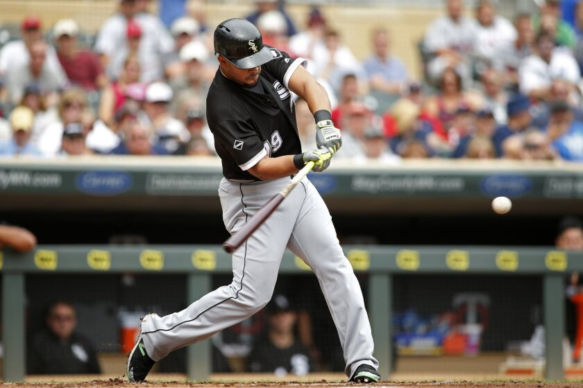 Chicago White Sox's Jose Abreu hits a three-run home run against the Minnesota Twins in the first inning of a baseball game Sunday, Sept. 4, 2016, in Minneapolis. (AP Photo/Bruce Kluckhohn)