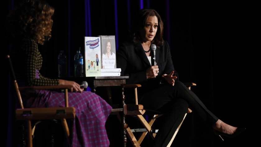 "Sen. Kamala Harris of California talks with author Cleo Wade about the senator's new memoir, ""The Truths We Hold,"" at the Wilshire Ebell Theatre in Los Angeles."