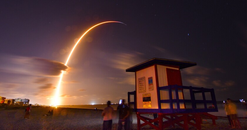 FILE - In this May 23, 2019, file photo, a Falcon 9 SpaceX rocket, with a payload of 60 satellites for SpaceX's Starlink broadband network, lifts off from Space Launch Complex 40 at Florida's Cape Canaveral Air Force Station, seen from Cocoa Beach, Fla. It's a 21st century space race: Amazon, SpaceX and others competing to get into orbit and provide internet to the earth's most remote places. (Malcolm Denemark/Florida Today via AP, File)