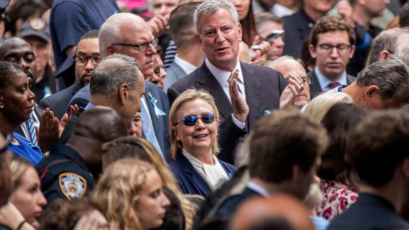 Democratic presidential candidate Hillary Clinton, center, attends a ceremony at the Sept. 11 memorial, in New York.