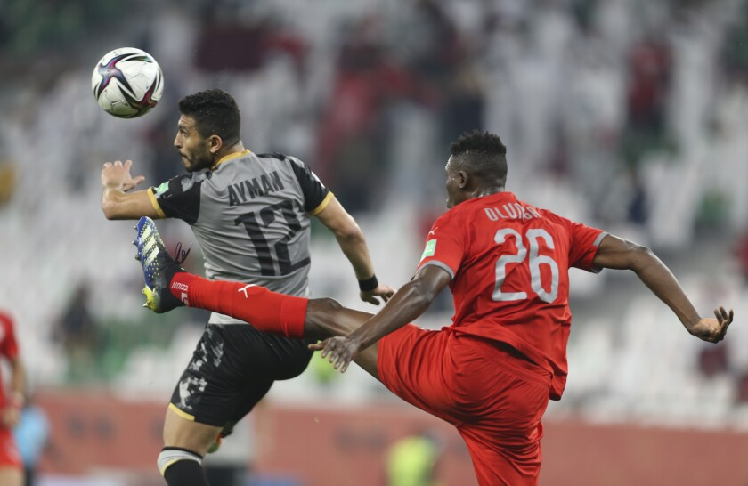 Al Duhail's Michael Olunga, rightt, and Al Ahly's Ashraf Ayman fight for the ball during FIFA Club World Cup in Al Rayyan, Qatar, Thursday, Feb. 4, 2021. (AP Photo/Hussein Sayed)