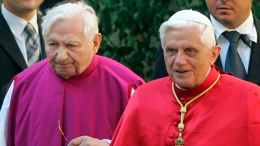 Pope Benedict XVI, right, walks with his brother Georg Ratzinger in Regensburg in southern Germany in 2006.