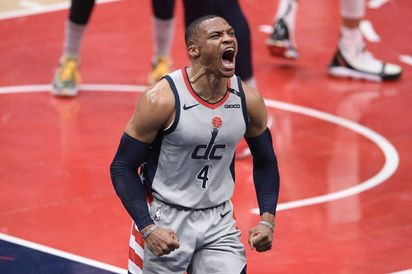 Washington Wizards guard Russell Westbrook (4) reacts during the first half the team's NBA basketball game against the New Orleans Pelicans, Friday, April 16, 2021, in Washington. (AP Photo/Nick Wass)