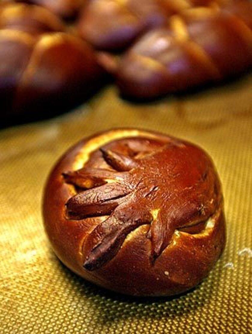 A handprint-topped Got Kosher? Rosh Hashana loaf.