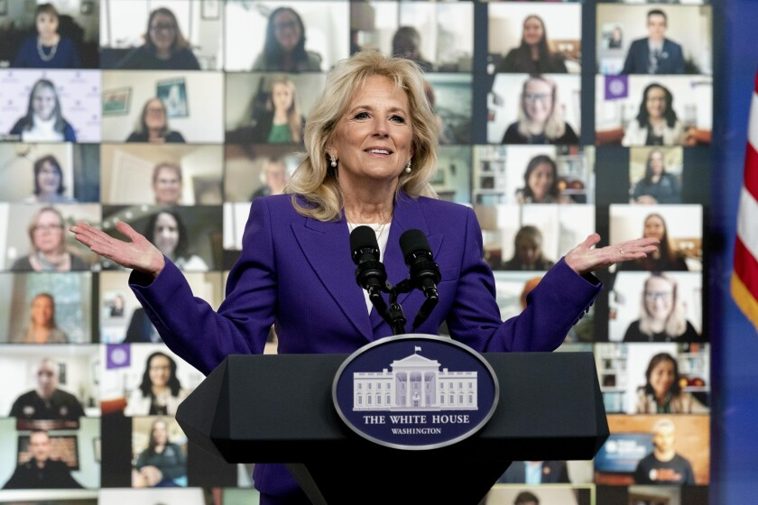 First lady Jill Biden speaks at a virtual event with military families from around the world as part of the White House initiative to support military and veteran families in the South Court Auditorium in the Eisenhower Executive Office Building on the White House Campus, Wednesday, April 7, 2021, in Washington. (AP Photo/Andrew Harnik)