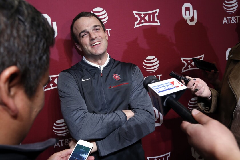 FILE - In this Jan. 26, 2018, file photo, Shane Beamer, then-assistant football coach at Oklahoma, speaks during a news conference in Norman, Okla. South Carolina's Shane Beamer hasn't had the smooth start every first-time football coach dreams about after getting the job. (Steve Sisney/The Oklahoman via AP, File)