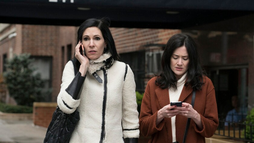 """Jill Kargman as Jill, left, and KK Glick as Vanessa search for """"Hamilton"""" tickets in an upcoming episode of Bravo's """"Odd Mom Out."""""""