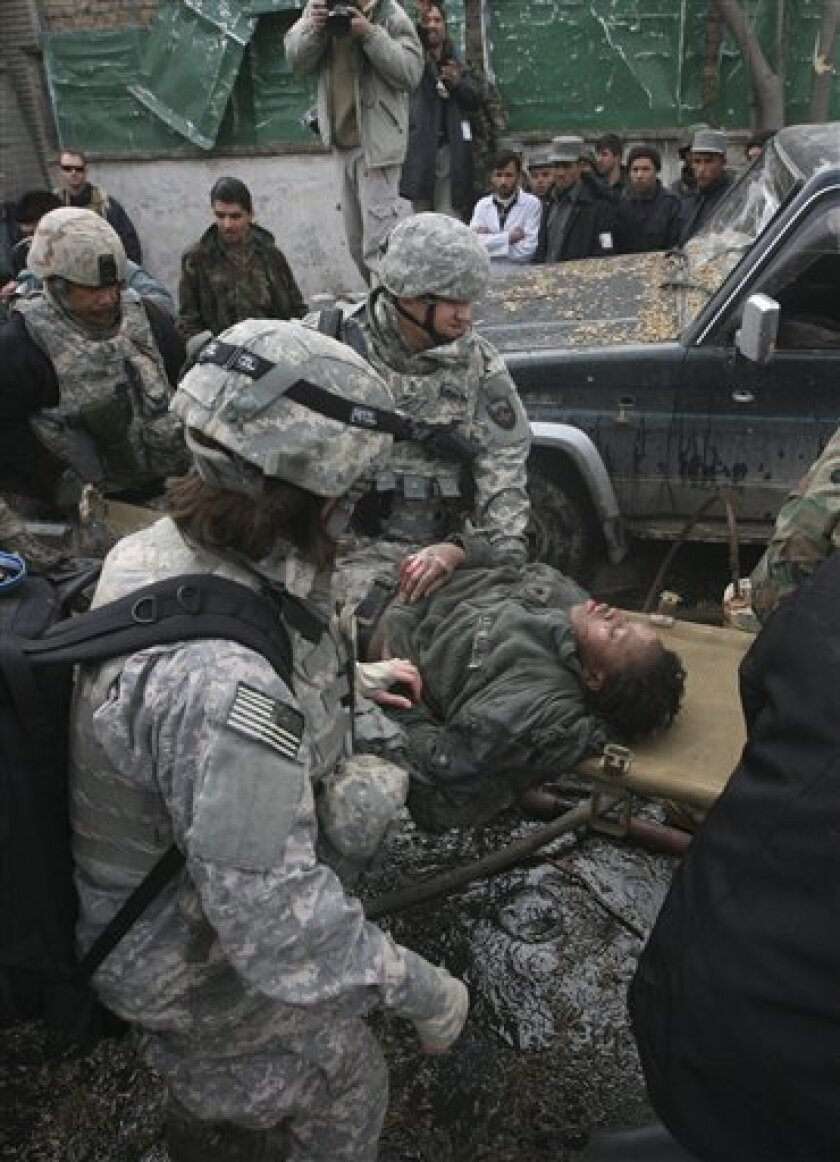 A wounded U.S. soldier is carried following a blast in Kabul, Afghanistan, on Saturday, Jan. 17, 2009.  A suicide car bomb attack on a heavily guarded road between the German Embassy and a U.S. military base set the embassy on fire Saturday, killing an Afghan child and wounding 21 people, including