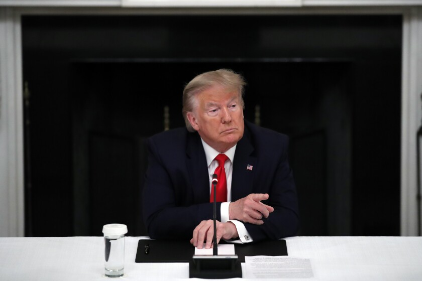 President Donald Trump listens during a roundtable with governors on the reopening of America's small businesses, in the State Dining Room of the White House, Thursday, June 18, 2020, in Washington. (AP Photo/Alex Brandon)