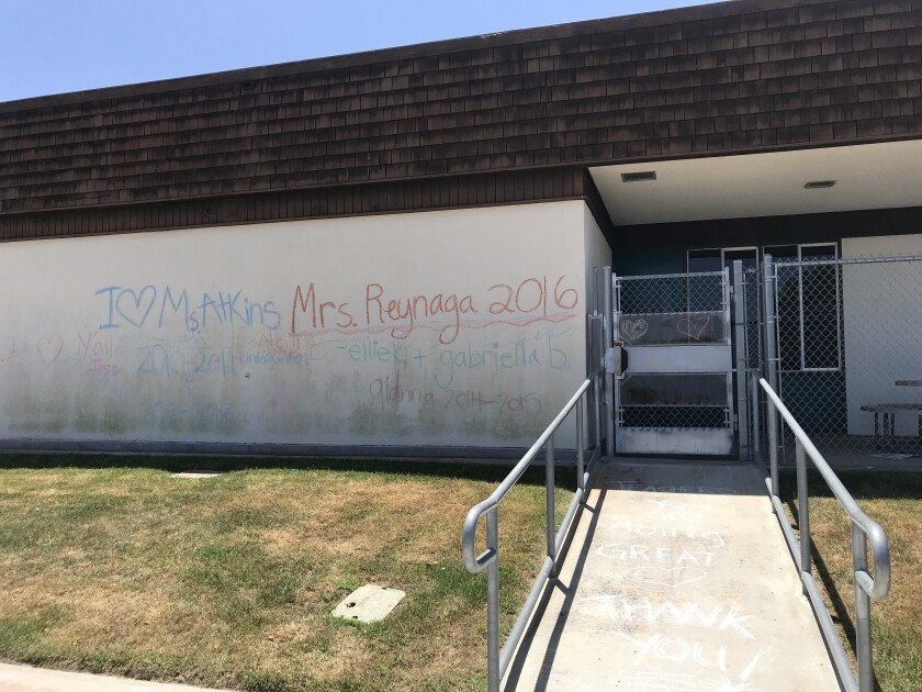 Thank you's to teachers written on the old school walls.