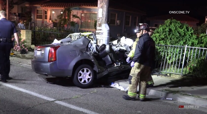 A Cadillac struck a telephone pole late Monday in National City, leaving the driver dead and an injured passenger trapped.