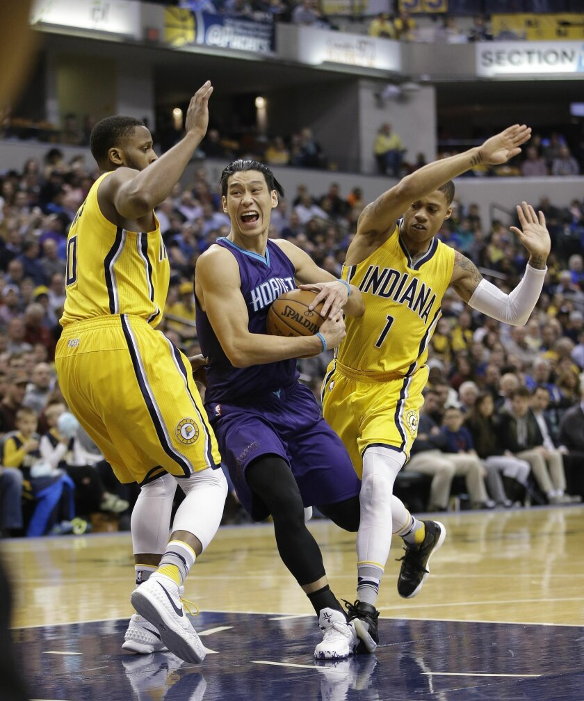Charlotte Hornets' Jeremy Lin (7) goes to the basket against Indiana Pacers' C.J. Miles (0) and Joe Young (1) during the first half of an NBA basketball game Wednesday, Feb. 10, 2016, in Indianapolis. (AP Photo/Darron Cummings)