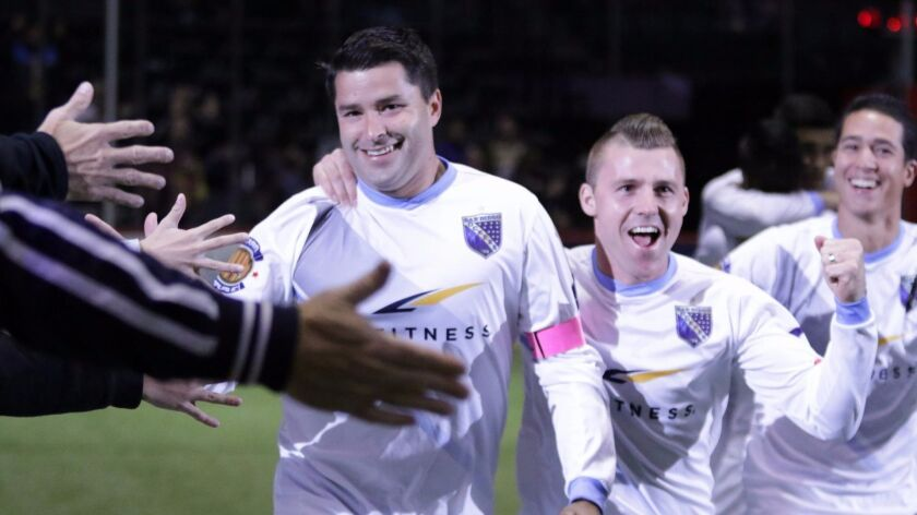 Sockers forward Kraig Chiles (far left) celebrates the first of his four goals in San Diego's 5-3 win on Friday night over Tacoma. Brian Farber (middle) provided the assist.