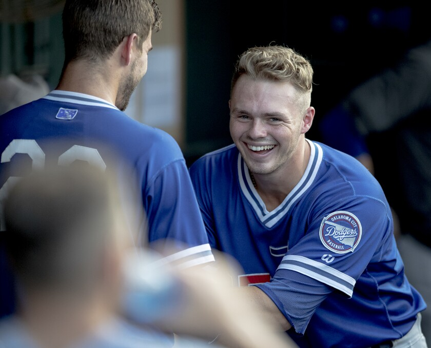 Oklahoma City shortstop Gavin Lux, right, laughs with teammate Drew Jackson before a game against Round Rock on Friday.