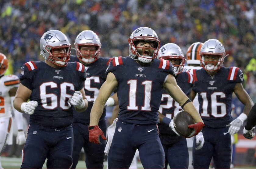 New England Patriots wide receiver Julian Edelman, center, celebrates his touchdown catch against the Cleveland Browns in October.