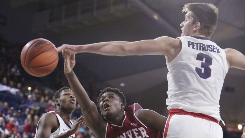 Gonzaga forward Filip Petrusev (3) blocks a shot by Denver forward David Nzekwesi (1) during the sec