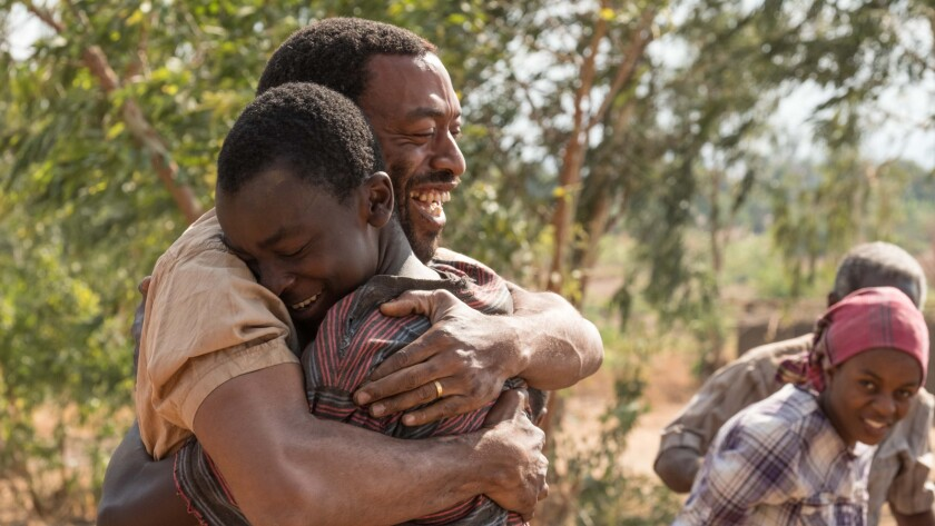 "Chiwetel Ejiofor, Maxwell Simba in the movie ""The Boy Who Harnessed the Wind."" Ilze Kitshoff / Netfl"