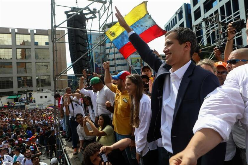 Juan Guaido, president of Venezuela's National Assembly (unicameral legislatura), waves to supporters in Caracas, Venezuela, on Jan. 23, 2019, after declaring himself Venezuela's interim president. EPA-EFE/Cristian Hernandez