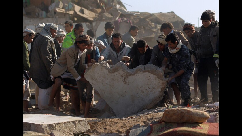 The search for survivors in the rubble of buildings destroyed during Saudi airstrikes near Sana Airport on March 26.
